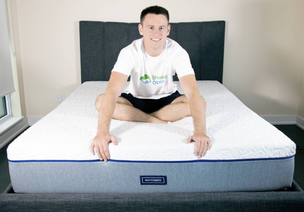 Alex Savy testing Novosbed Mattress