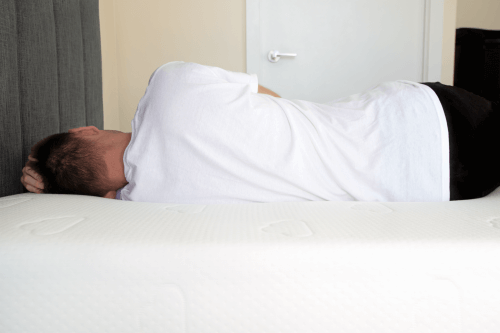 position of your back while sleeping on Puffy mattress